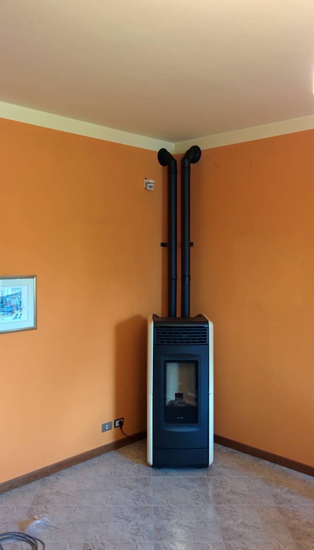 Installazione canna fumaria per stufa a pellet marchio - Stufe da camera ...